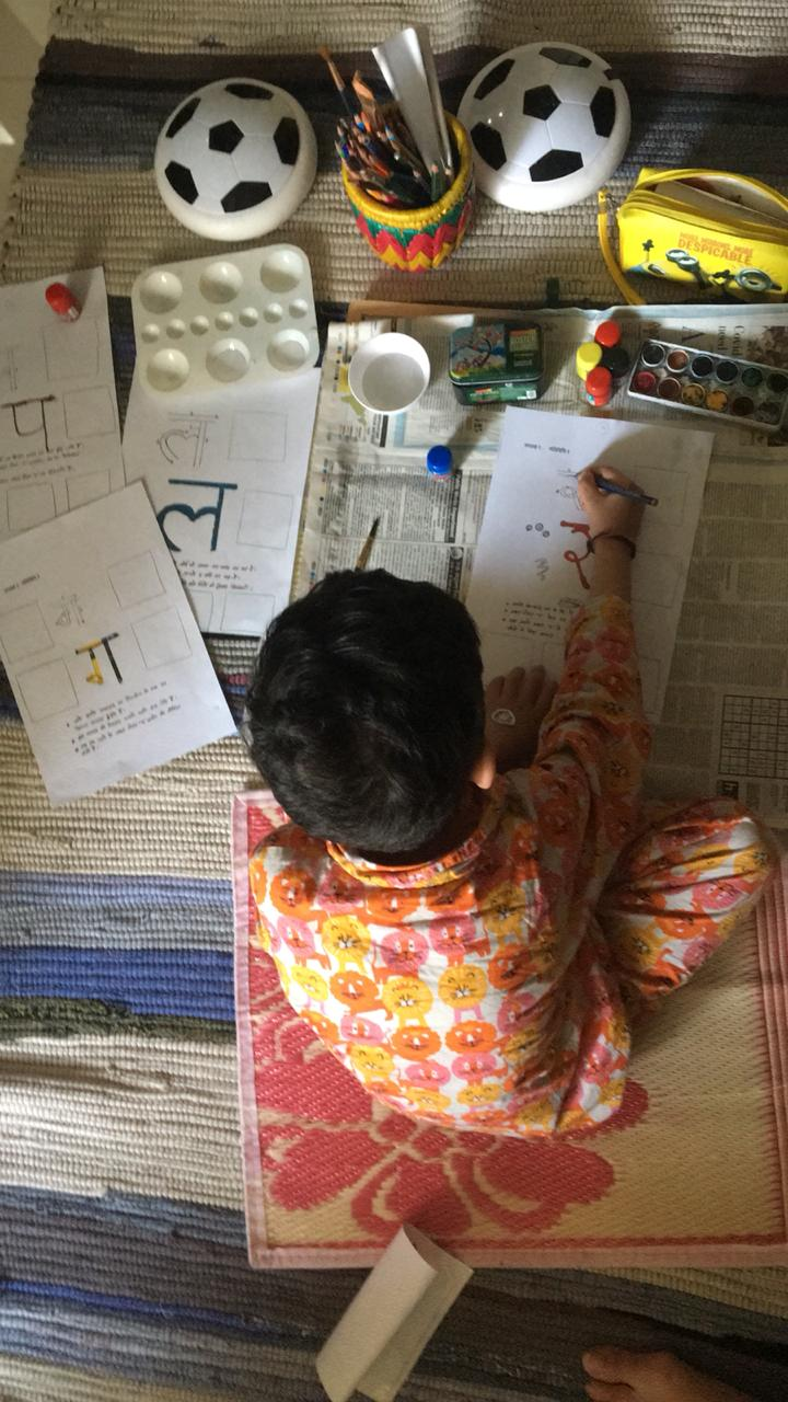 Life skill to teach your kid - child writing creatively