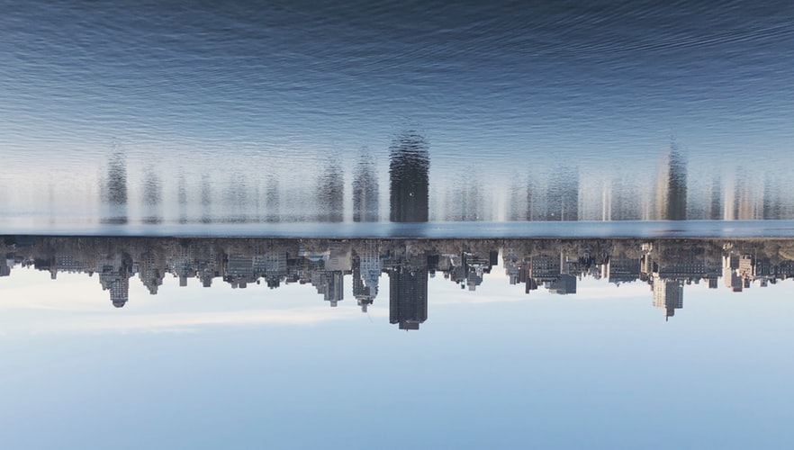 Upside down view of New York City with reflection on water