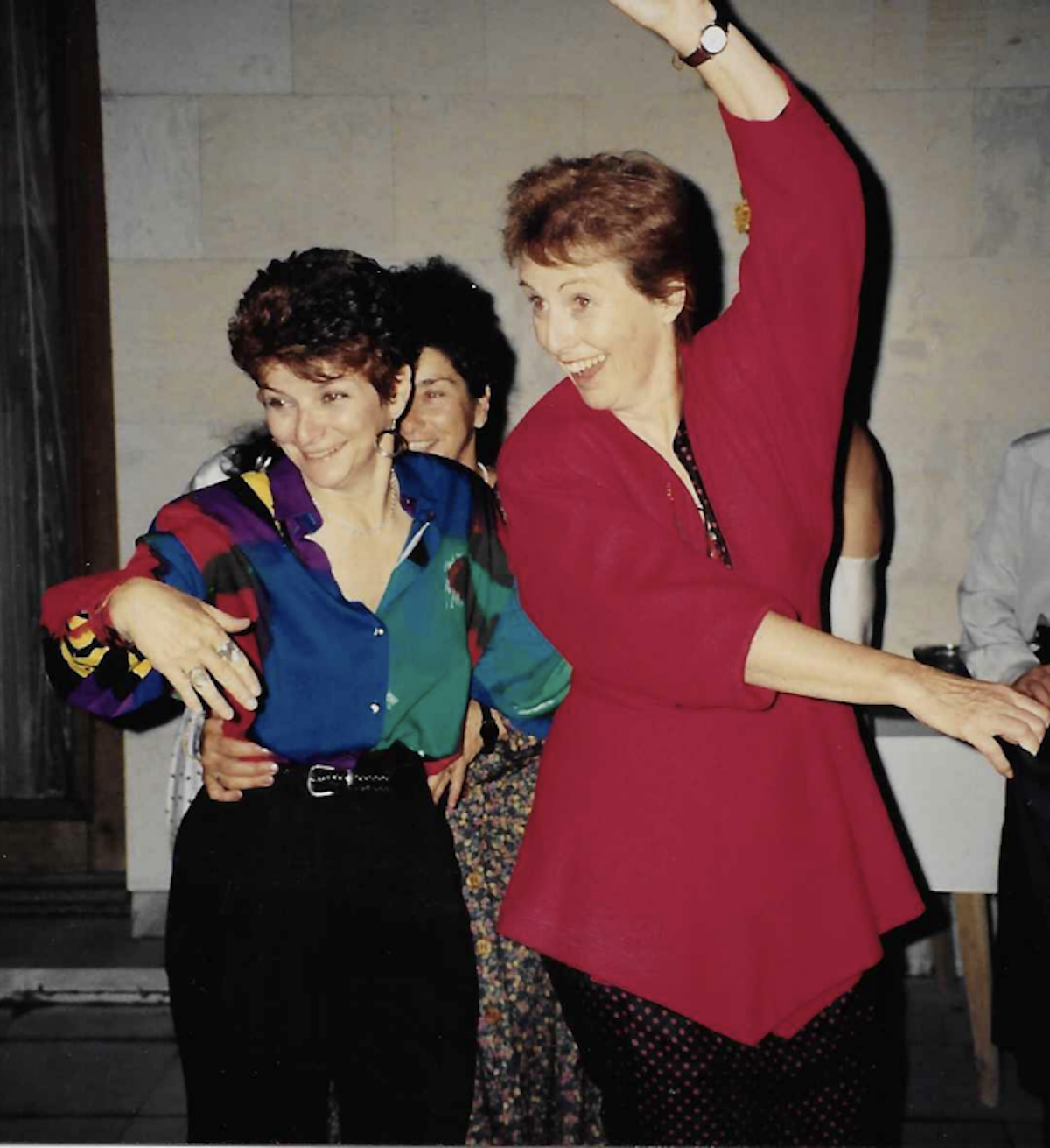 Sylvia Spring, filmmaker and co-founder of MediaWatch dancing with then Executive Director, Meg Hogarth at a women's event in Bulgaria 1994. Meg died last month in Toronto at 84.