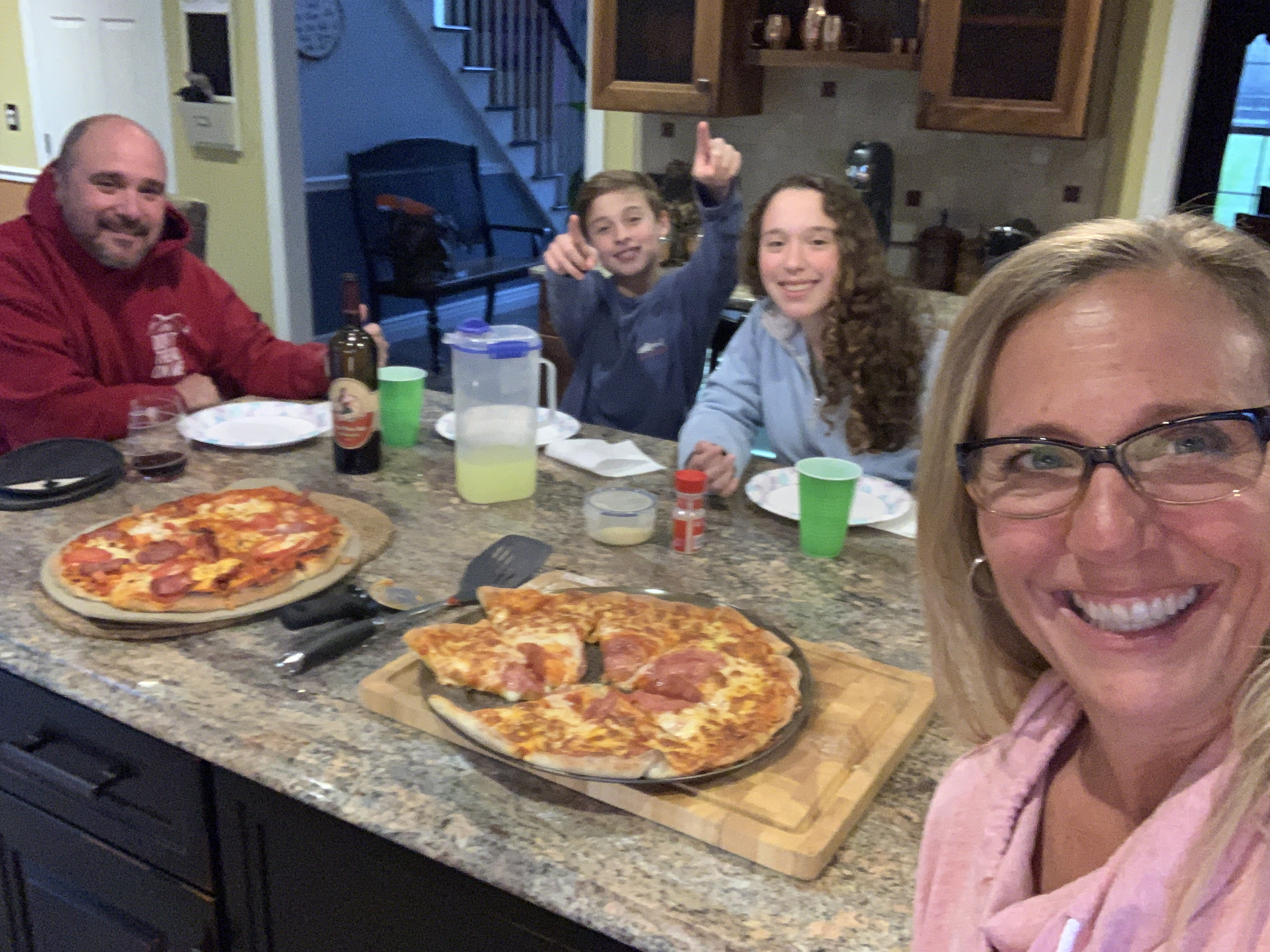 Ramalho Family Enjoying Homemade Pizza