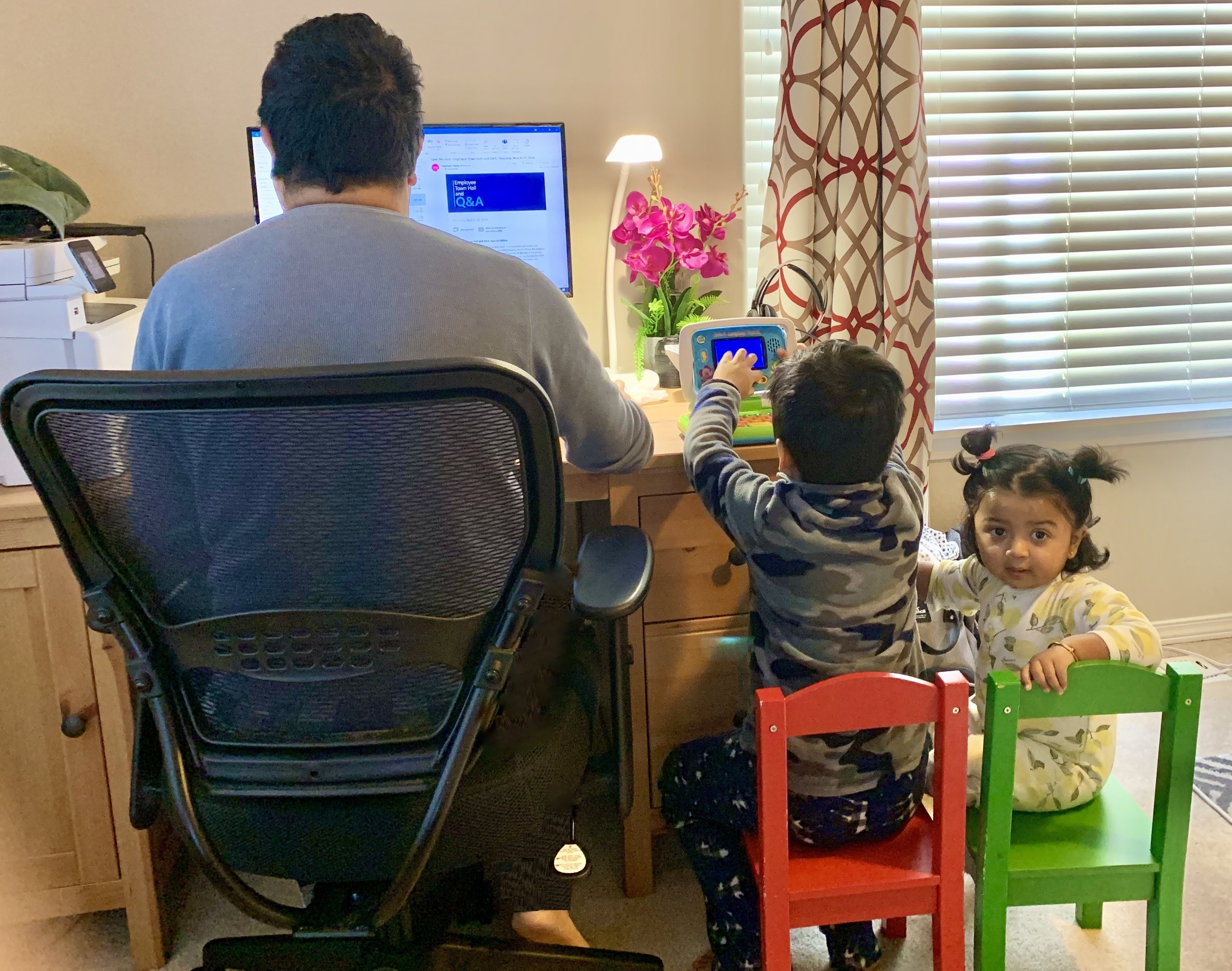 A Dad with his kids while working from home (Photo taken by the Mom)