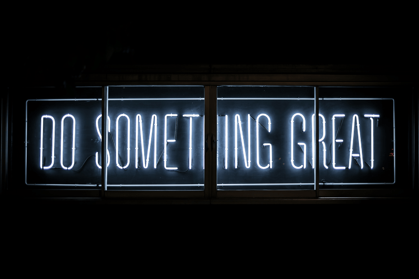 """""""DO SOMETHING GREAT"""" neon sign in black background 