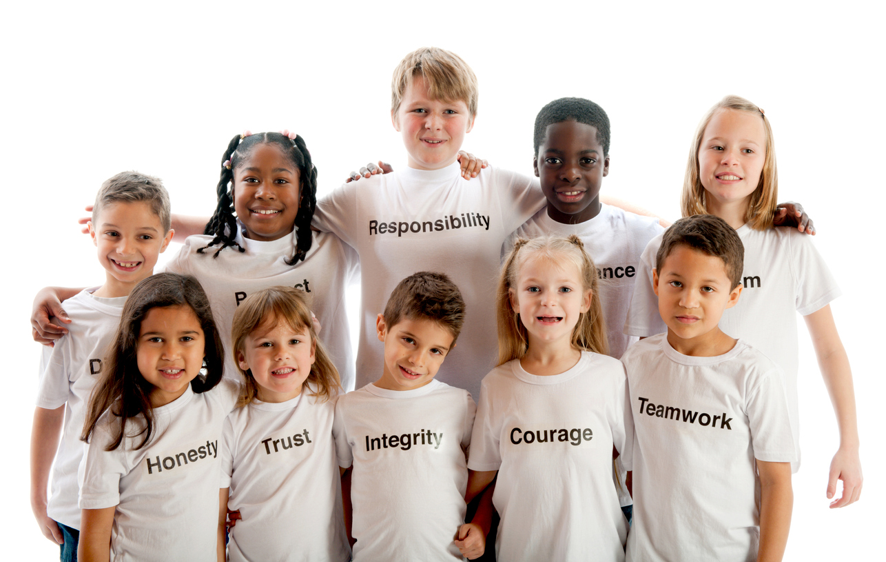 Ten children wearing shirts with character traits.
