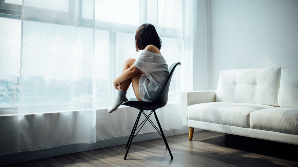Lead image of woman sitting alone