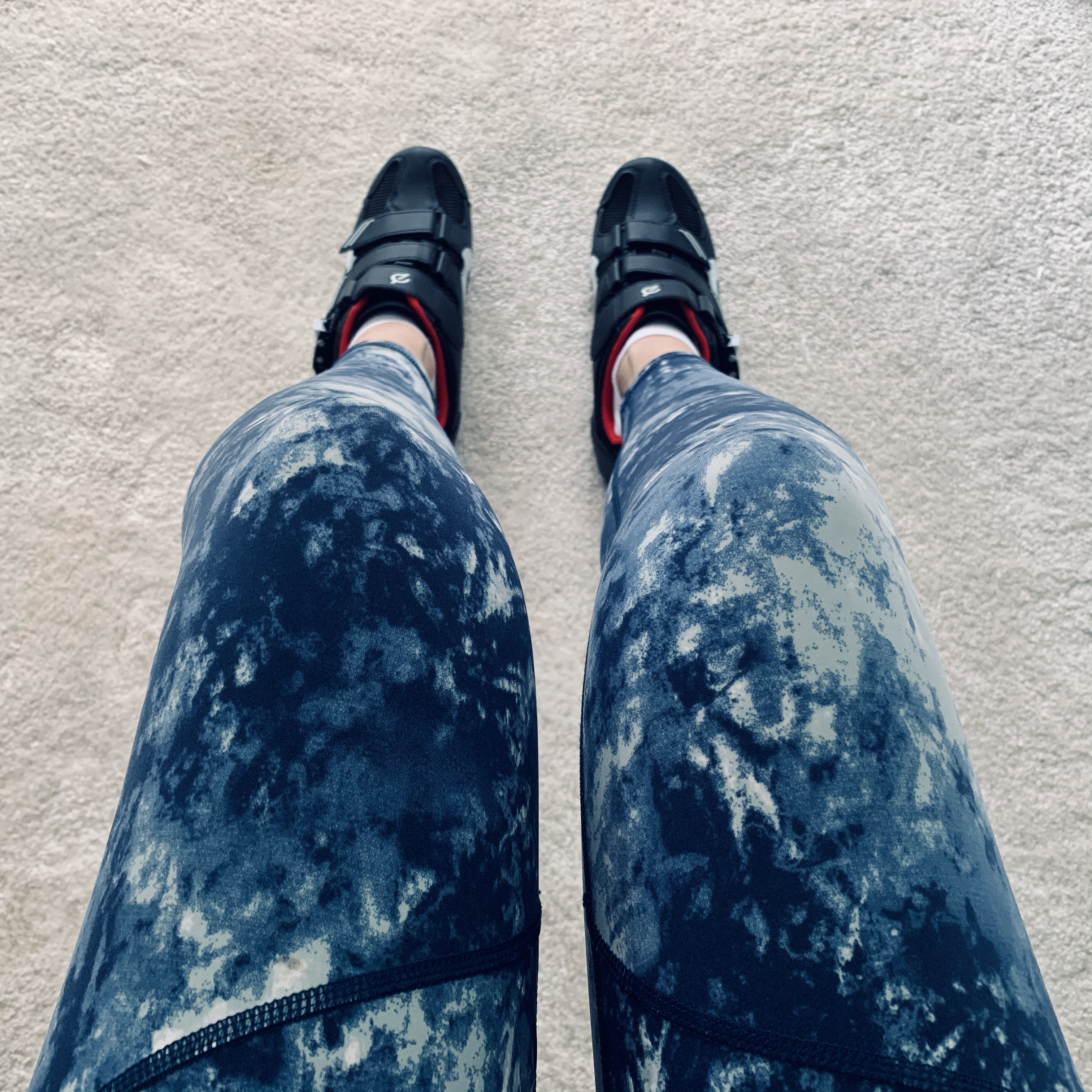 Girl's legs who is wearing cycling leggings and shoes