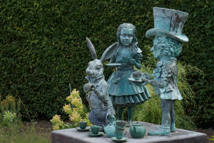 Stone Garden Statues of Alice in Wonderland, the White Rabbit and the Mad Hatter