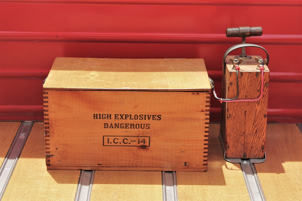 A wooden box of explosives attached to a old style detonator