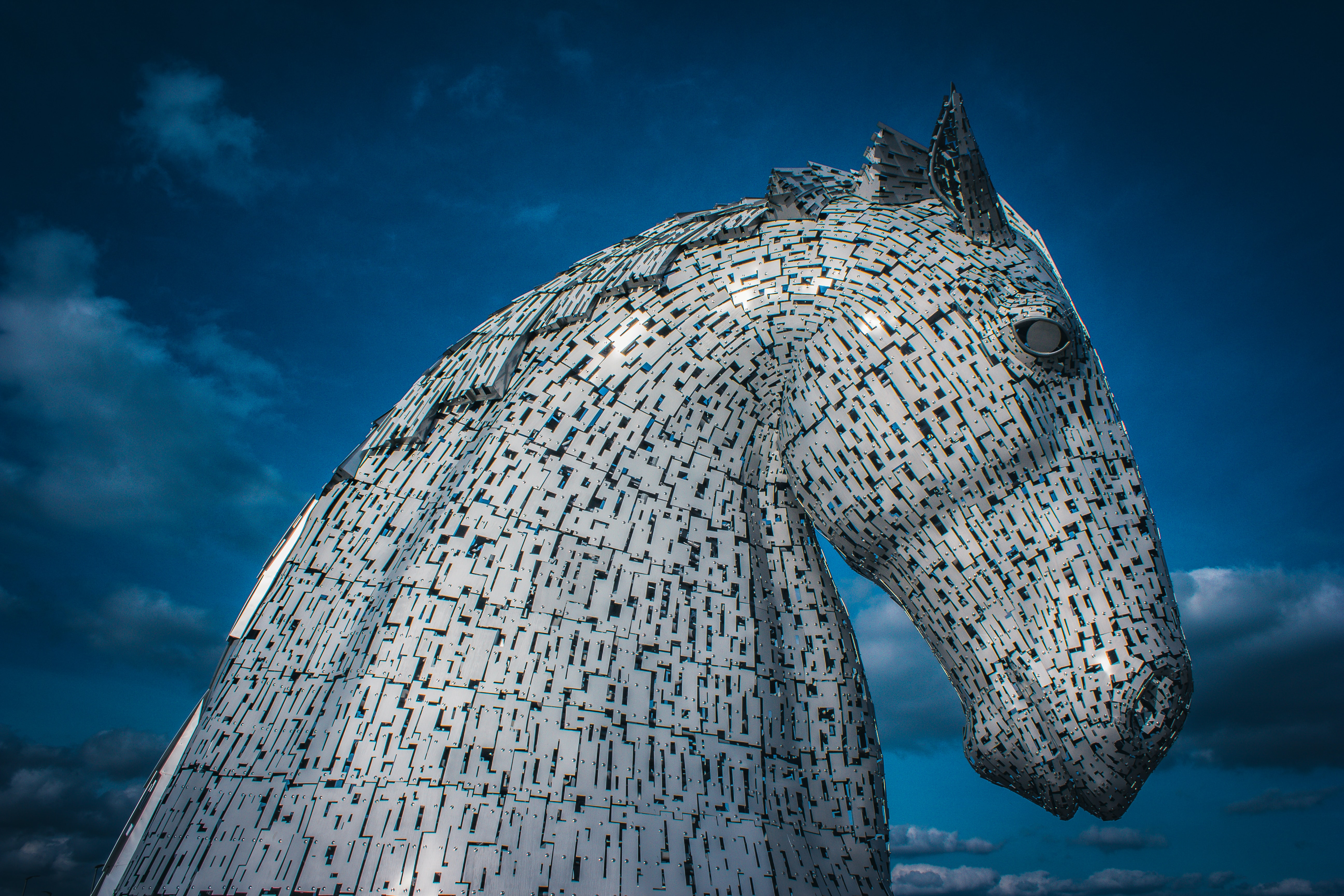 metal horse sculpture against blue sky