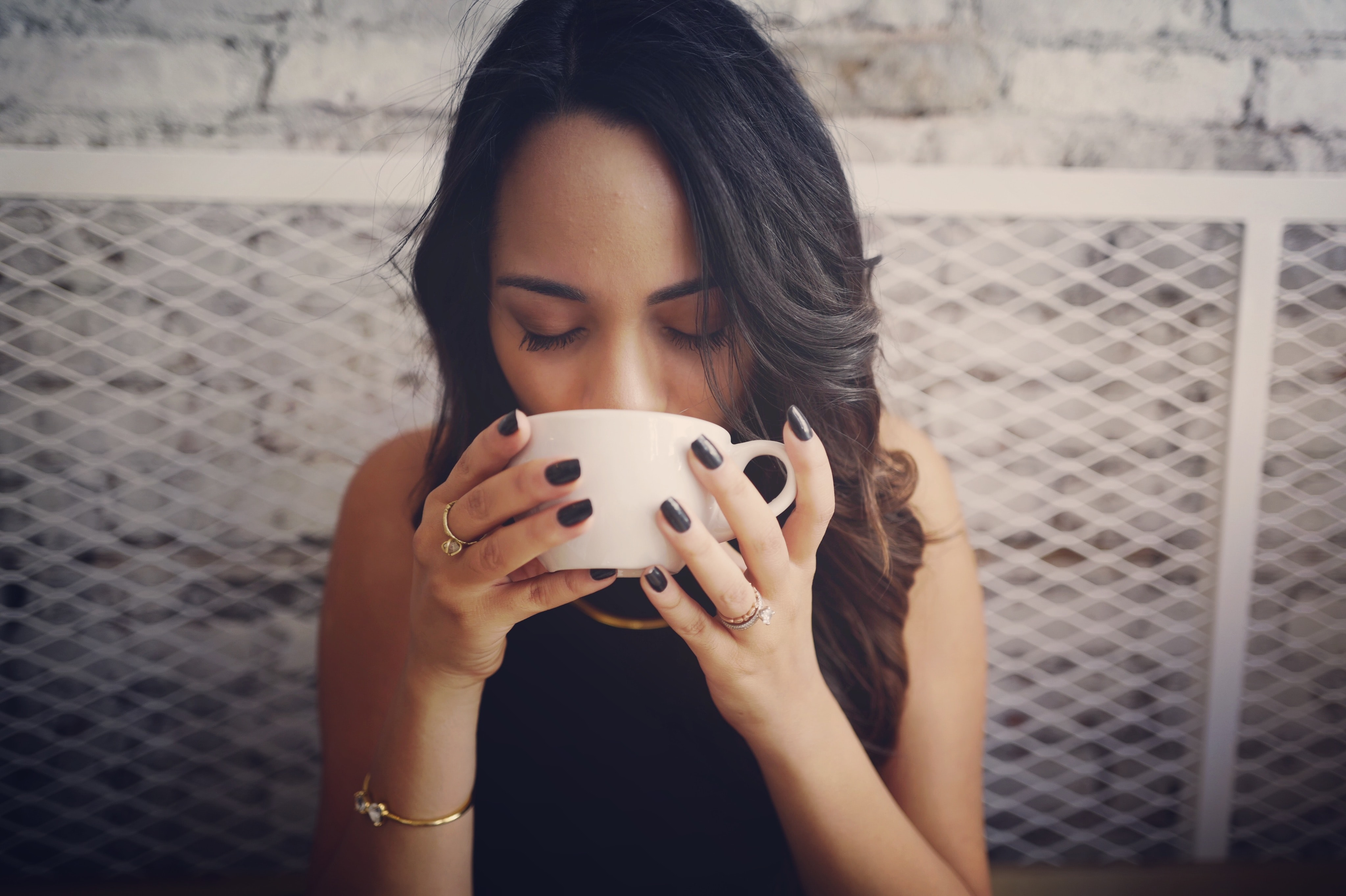 Image of a woman drinking herbal tea.