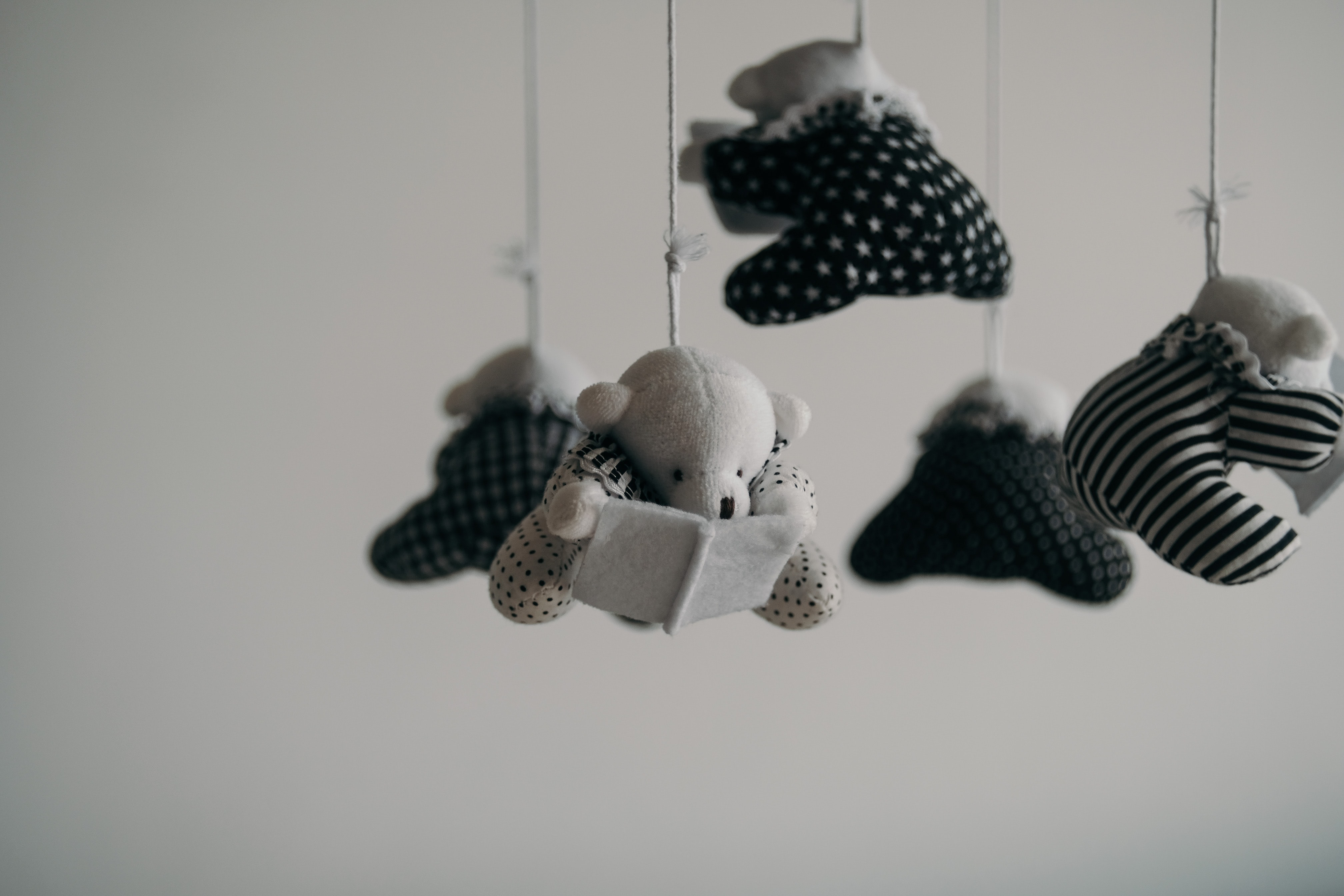 The black and white baby mobile represents the intersection between infertility trauma and racial trauma.