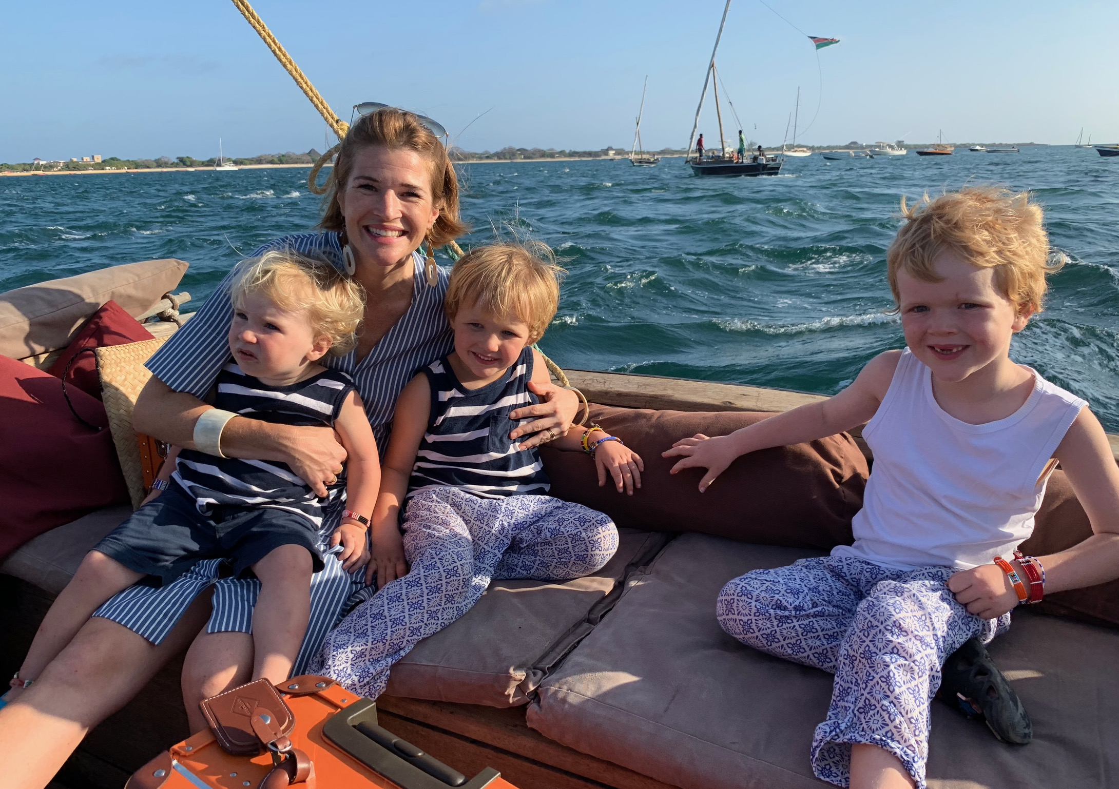 Sara Banks with three of her four sons off the coast of Lamu, Kenya, in 2019.