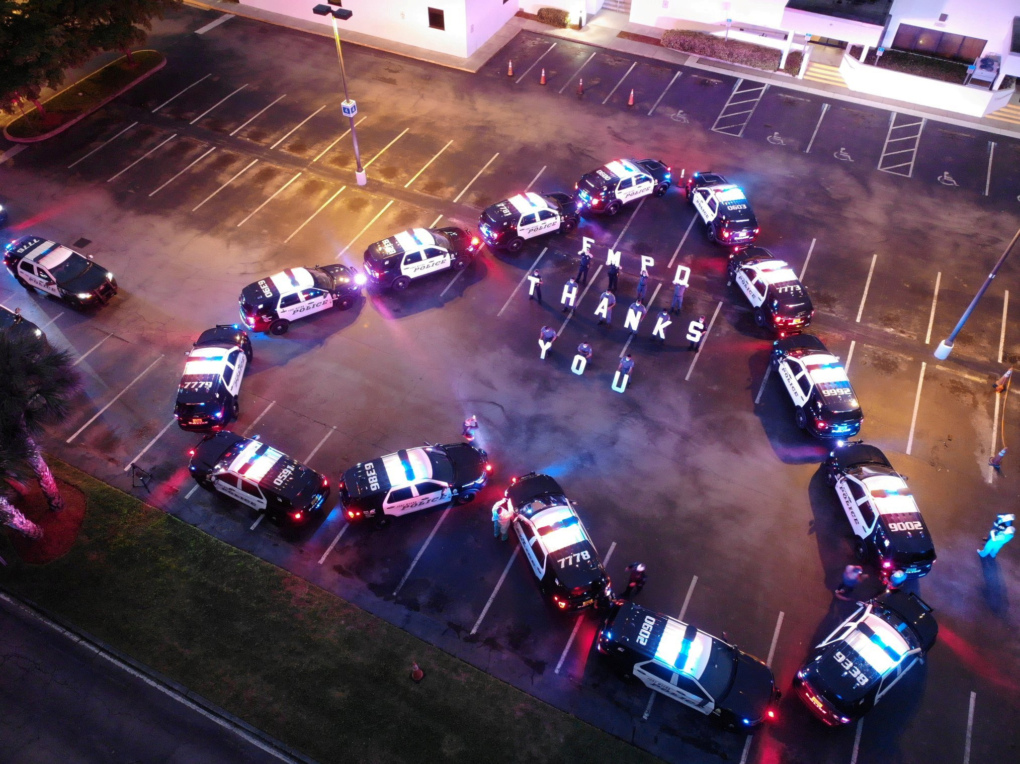 The Fort Myers Police Department makes heart out of police cars to thank health workers at Lee Memorial Hospital, in Fort Myers, U.S., April 16, 2020 in this picture obtained from social media. FORT MYERS POLICE DEPARTMENT/via REUTERS THIS IMAGE HAS BEEN SUPPLIED BY A THIRD PARTY. MANDATORY CREDIT.     TPX IMAGES OF THE DAY