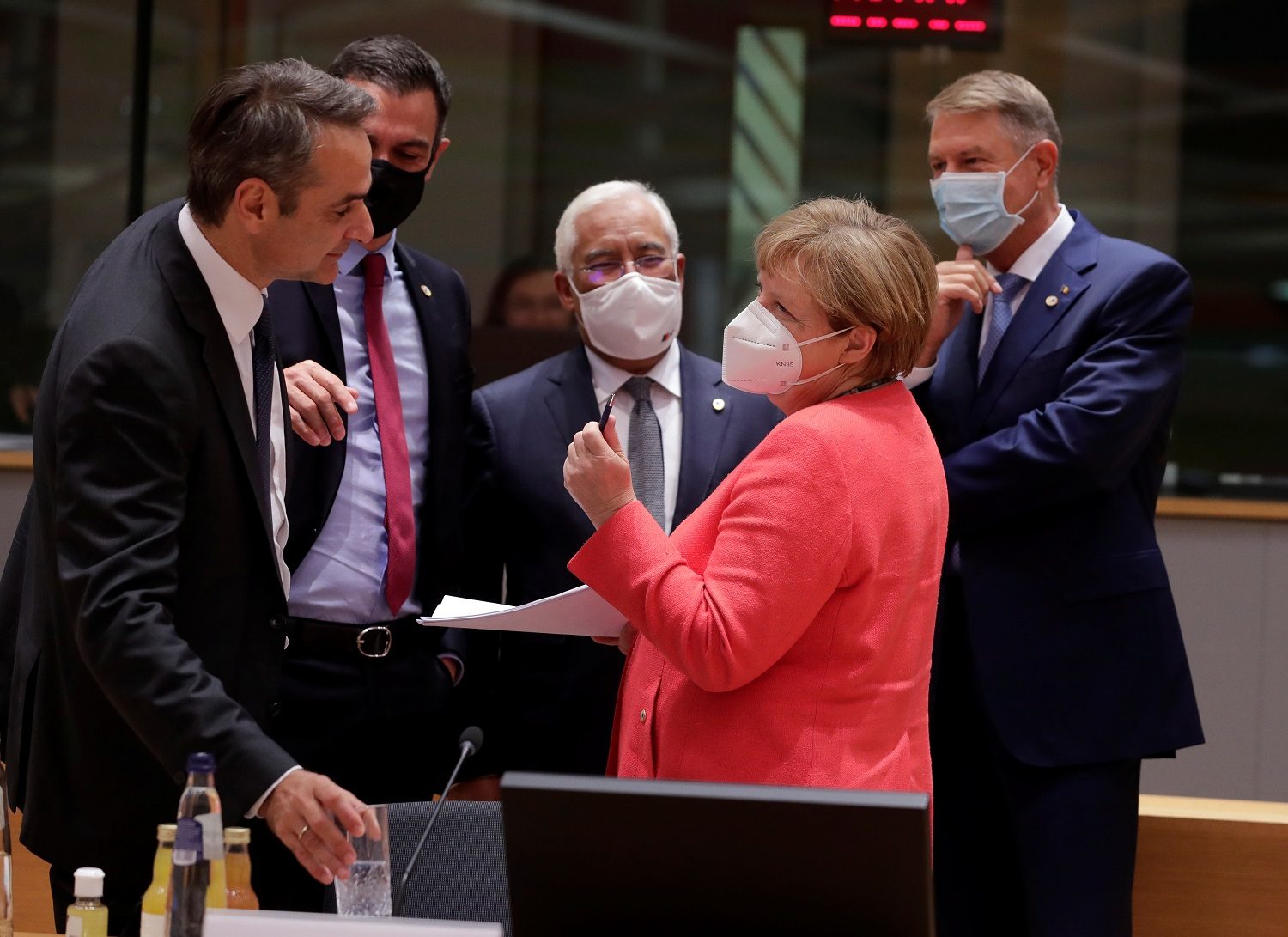 Greece's Prime Minister Kyriakos Mitsotakis, Spanish Prime Minister Pedro Sanchez, Portugal's Prime Minister Antonio Costa, Germany's Chancellor Angela Merkel and Romanian President Klaus Iohannis interact while wearing face masks during the last roundtable discussion following a four-day European summit at the European Council in Brussels, Belgium, July 21, 2020. Stephanie Lecocq/Pool via REUTERS