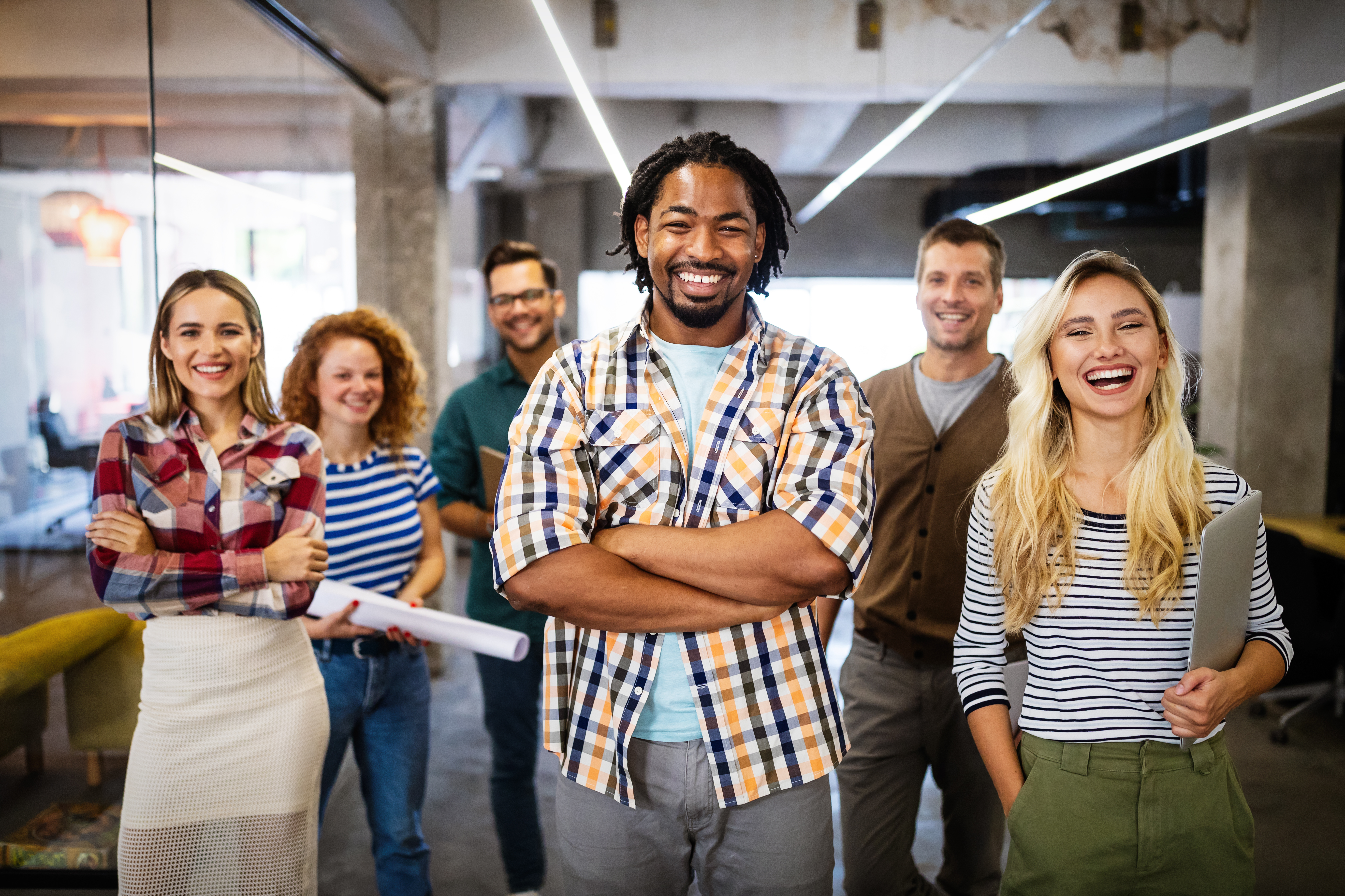 Successful company with happy employees colleagues in modern office