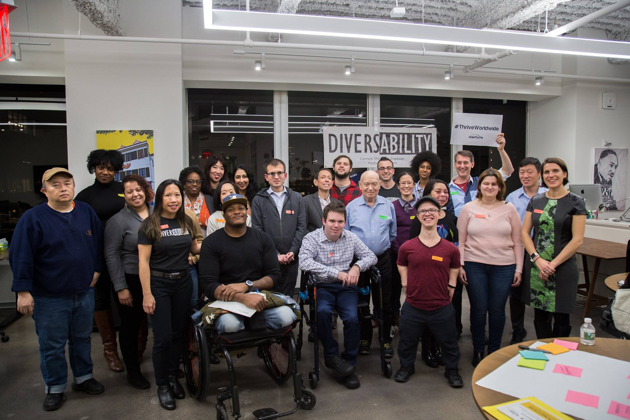 [Photo Description: A large group of Diversability community members posing for a photo at a community event]