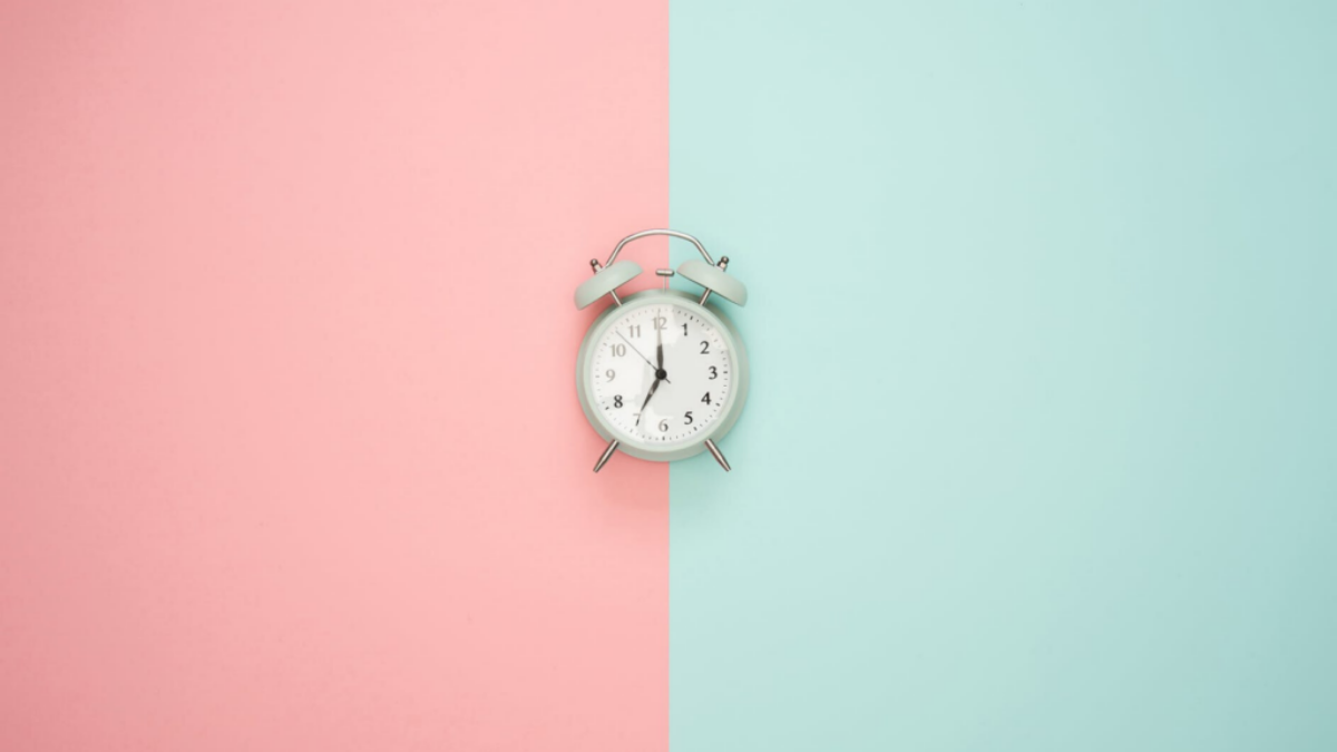 Clock on pink and blue background