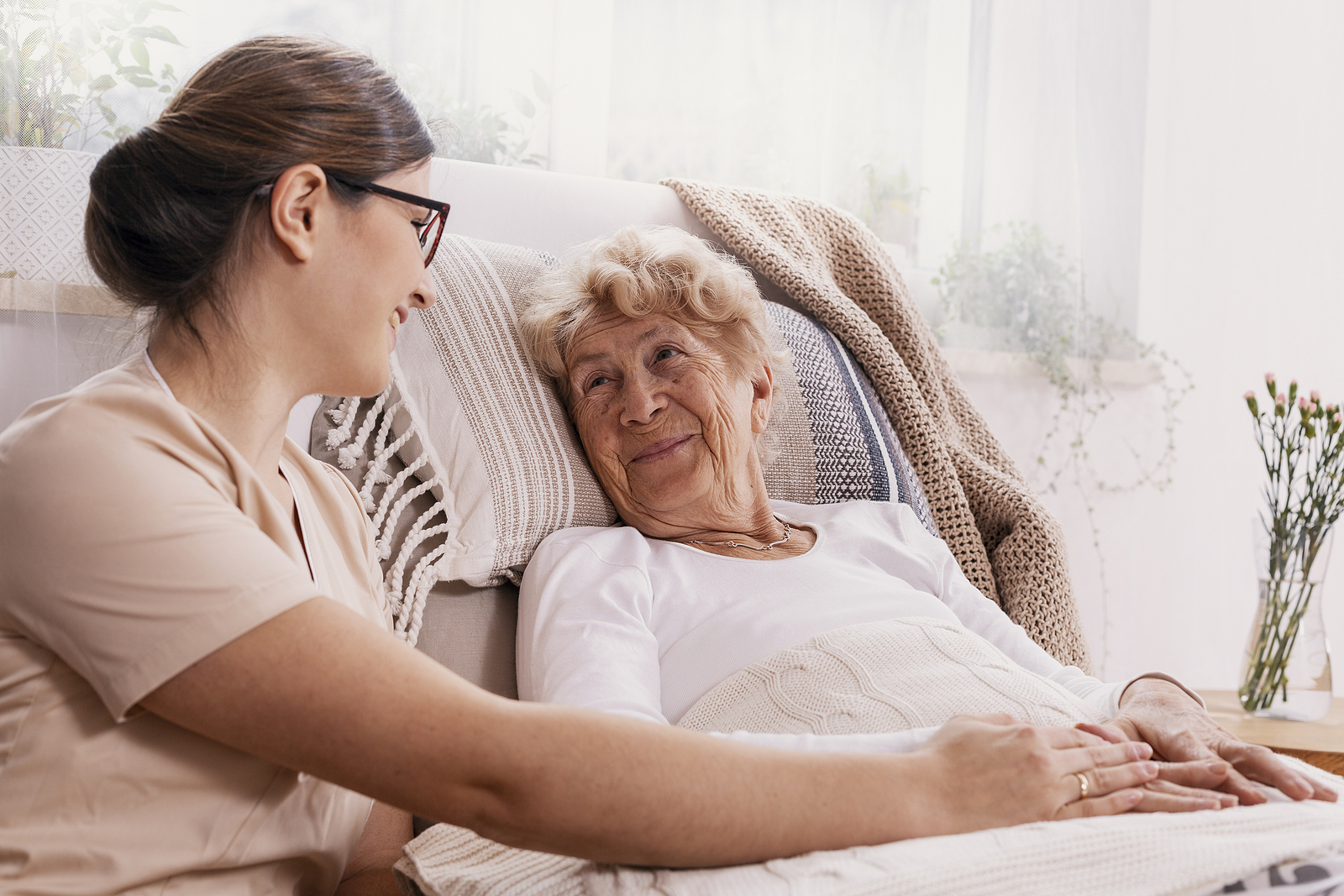 Social worker helping elderly person in retirement home