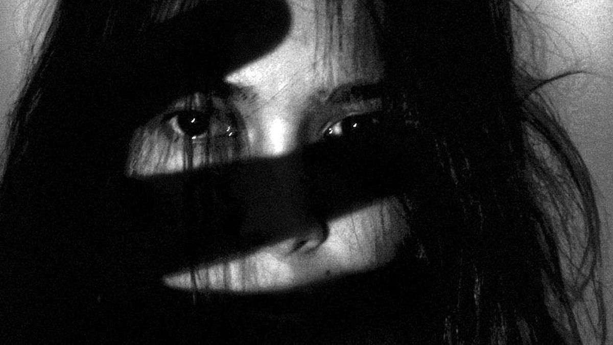 A woman with a shadow over her face