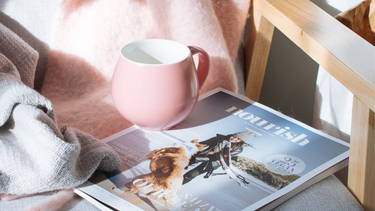 pink cup and magazine
