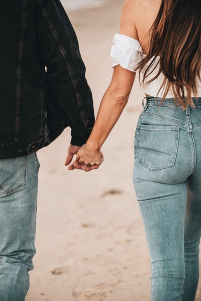 Unsplash: Man and Woman Holding Hands in Denim Jeans