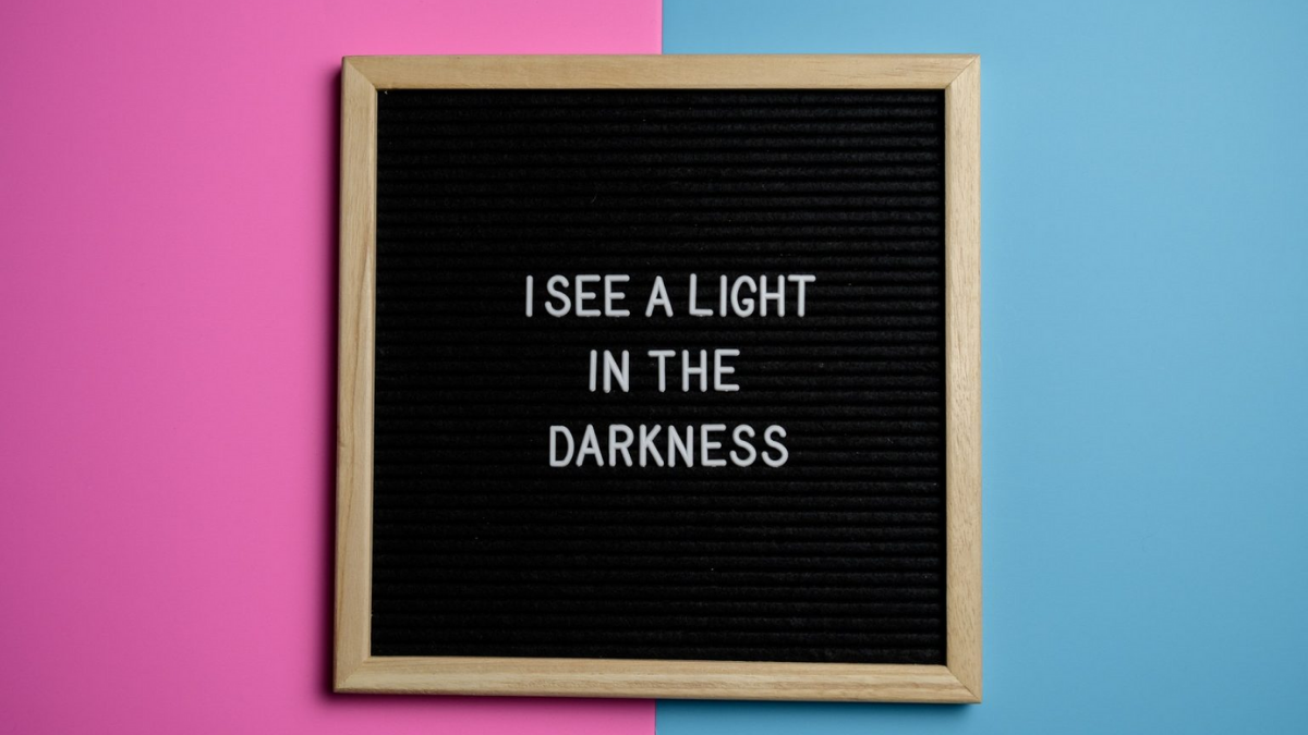 I see the light in the darkness text in letter board