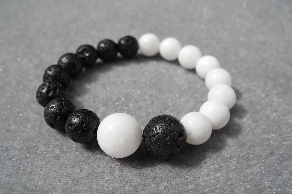 A yin yang bracelet with black and white beads