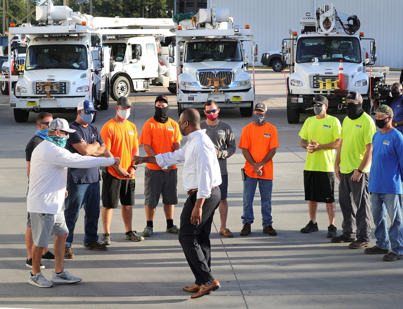 Orlando Utilities Commission vice president LeMoyne Adams, center, thanks lineworkers during a meeting before their departure from OUC's Pershing Operations Center in Orlando, Fla. for Lafayette, La., Thursday, Aug. 27, 2020. A dozen OUC workers volunteered to assist with power restoration efforts in the wake of the devastation from Hurricane Laura that struck the Louisiana coastline Thursday morning. The lineworkers will join up with other municipal utilities from across the U.S. as a part of a coordinated mutual aid response to the category 4 hurricane. (Photo by Joe Burbank/Orlando Sentinel/TNS/Sipa USA) No Use UK. No Use Germany.