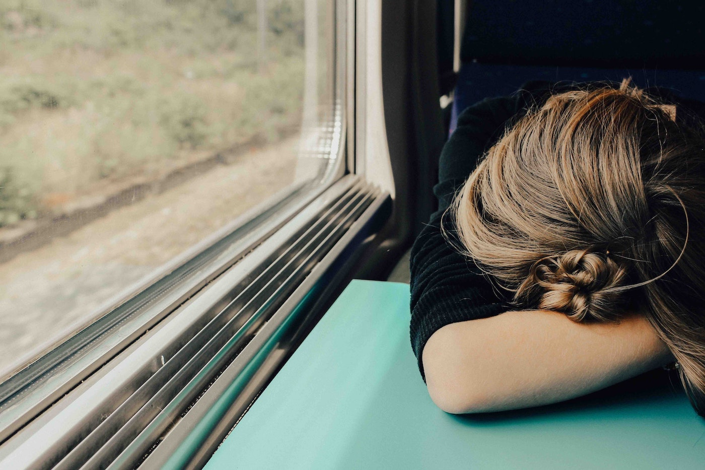 Lady on train feeling burned out.