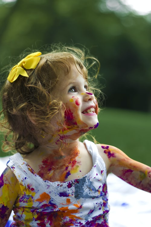 toddler with paint on her body