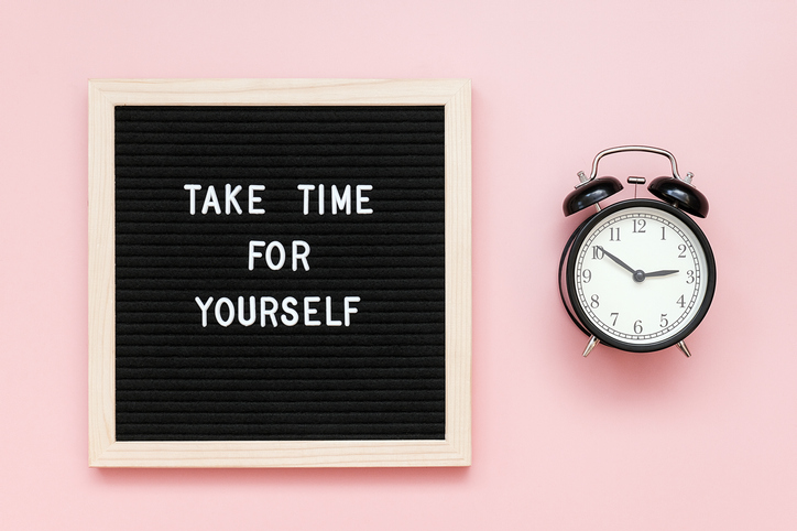 Take time for yourself. Motivational quote on letterboard and black alarm clock on pink background. Top view Flat lay Copy space Concept inspirational quote of the day.