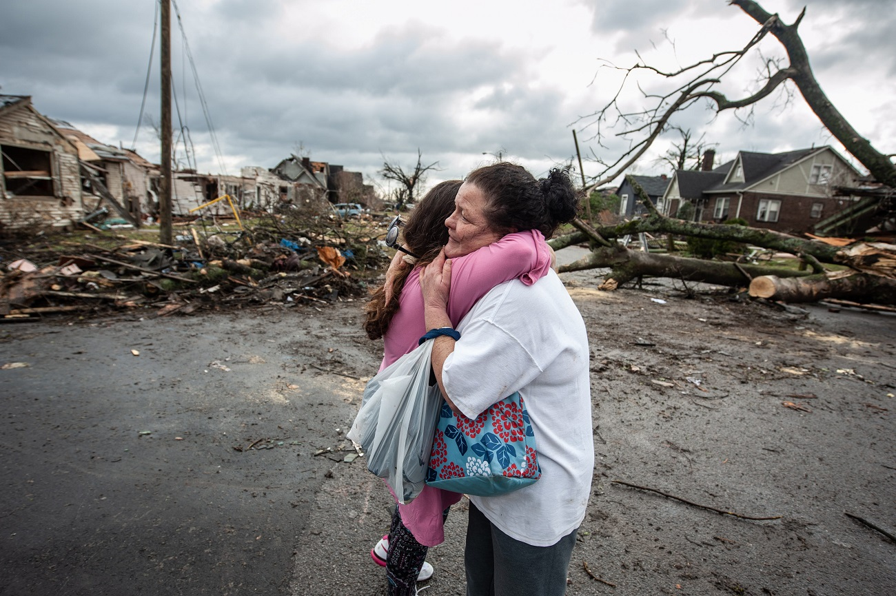 Michelle Temple hugs neighbor Paula Morgan on Holly Street. Her home is at the left  in East Nashville, Tenn., on March 3.