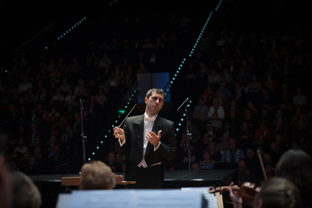 An orchestra conductor in the middle of a performance