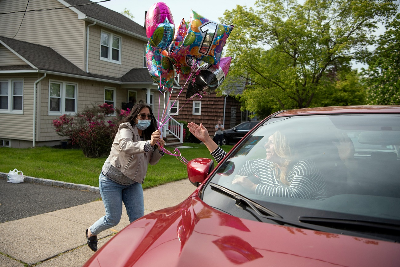 Friends and family drop off balloons for Fran LaSala, not pictured, during a drive-by birthday celebration on her 103rd birthday outside of her Cedar Grove home on May 19, 2020. LaSala misses working five days a week at Seton Hall since the university closed during the coronavirus pandemic.News Coronavirus Church Churches Reopen Covid Response Food Insecurity
