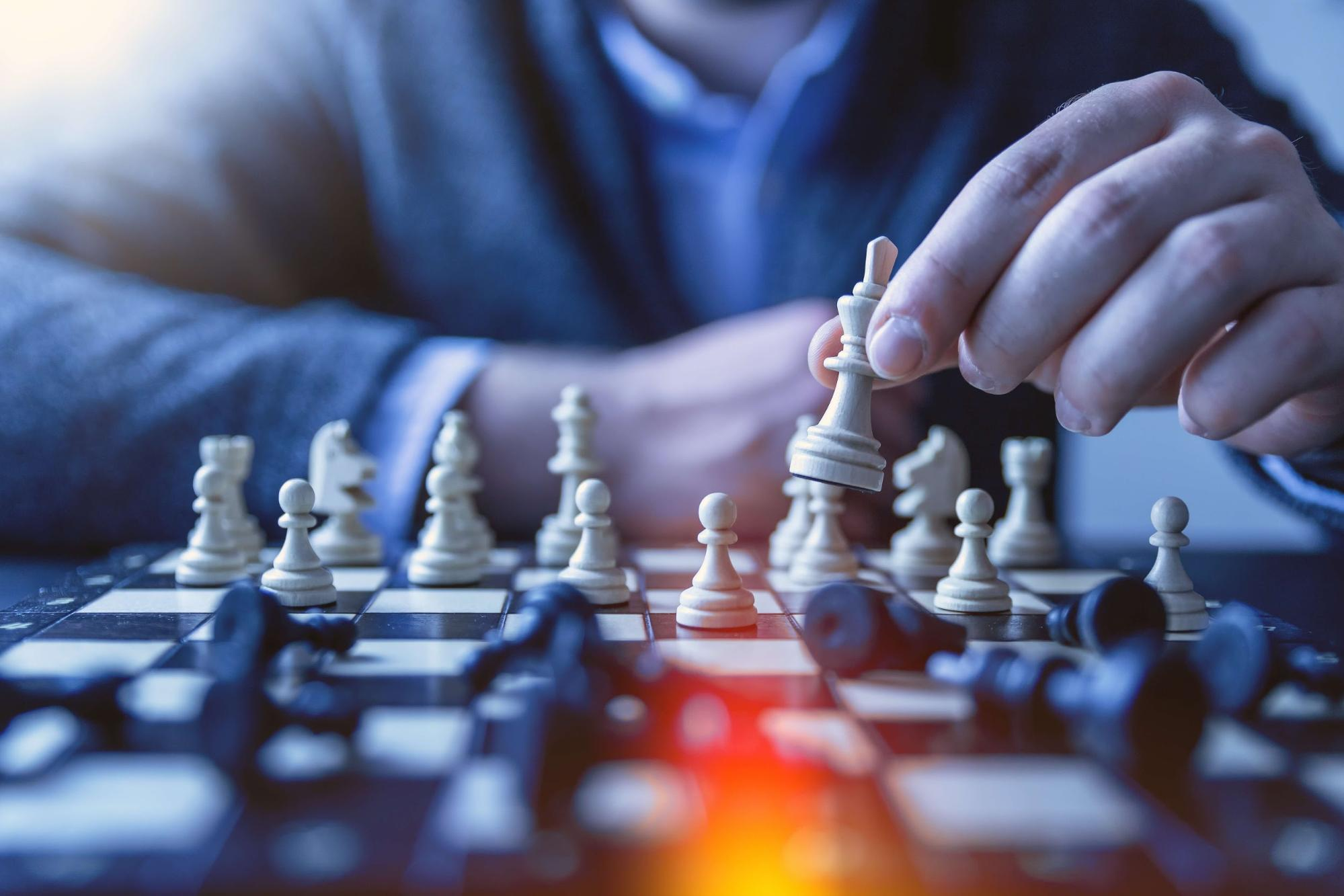 Man using chess to improve decision making
