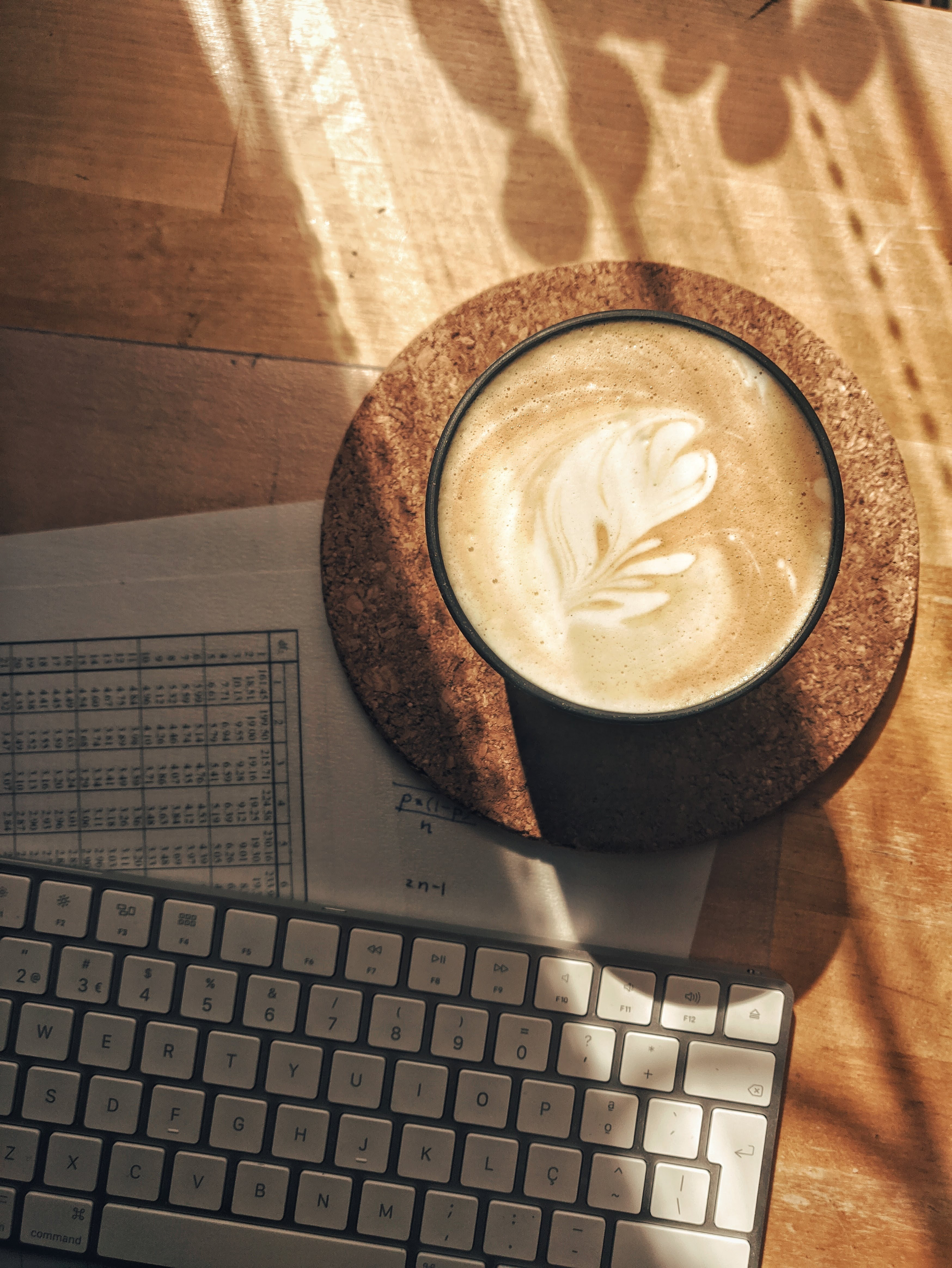 Relaxing coffee next to computer