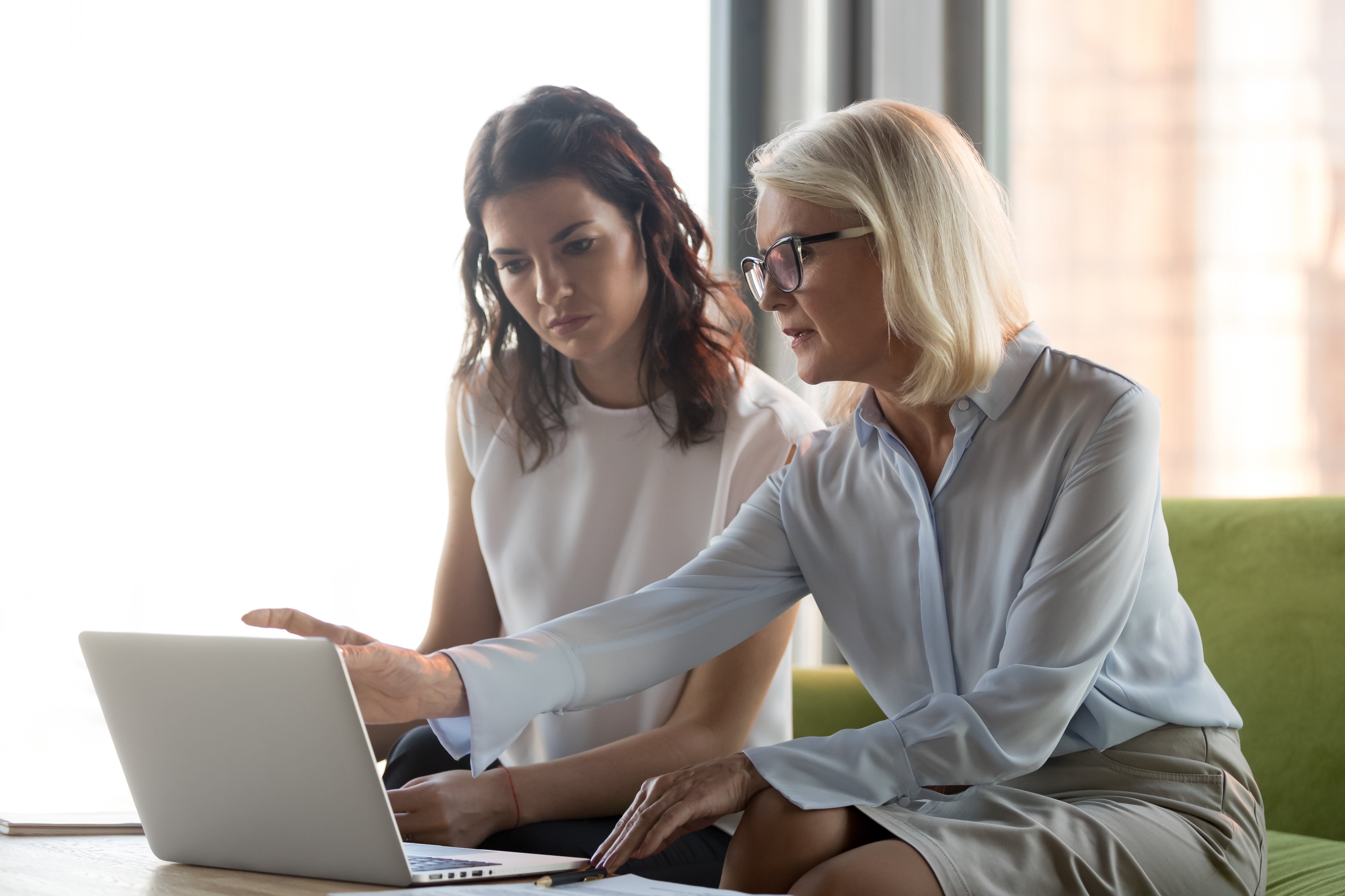 Middle aged woman mentoring young woman (Adobe stock image)