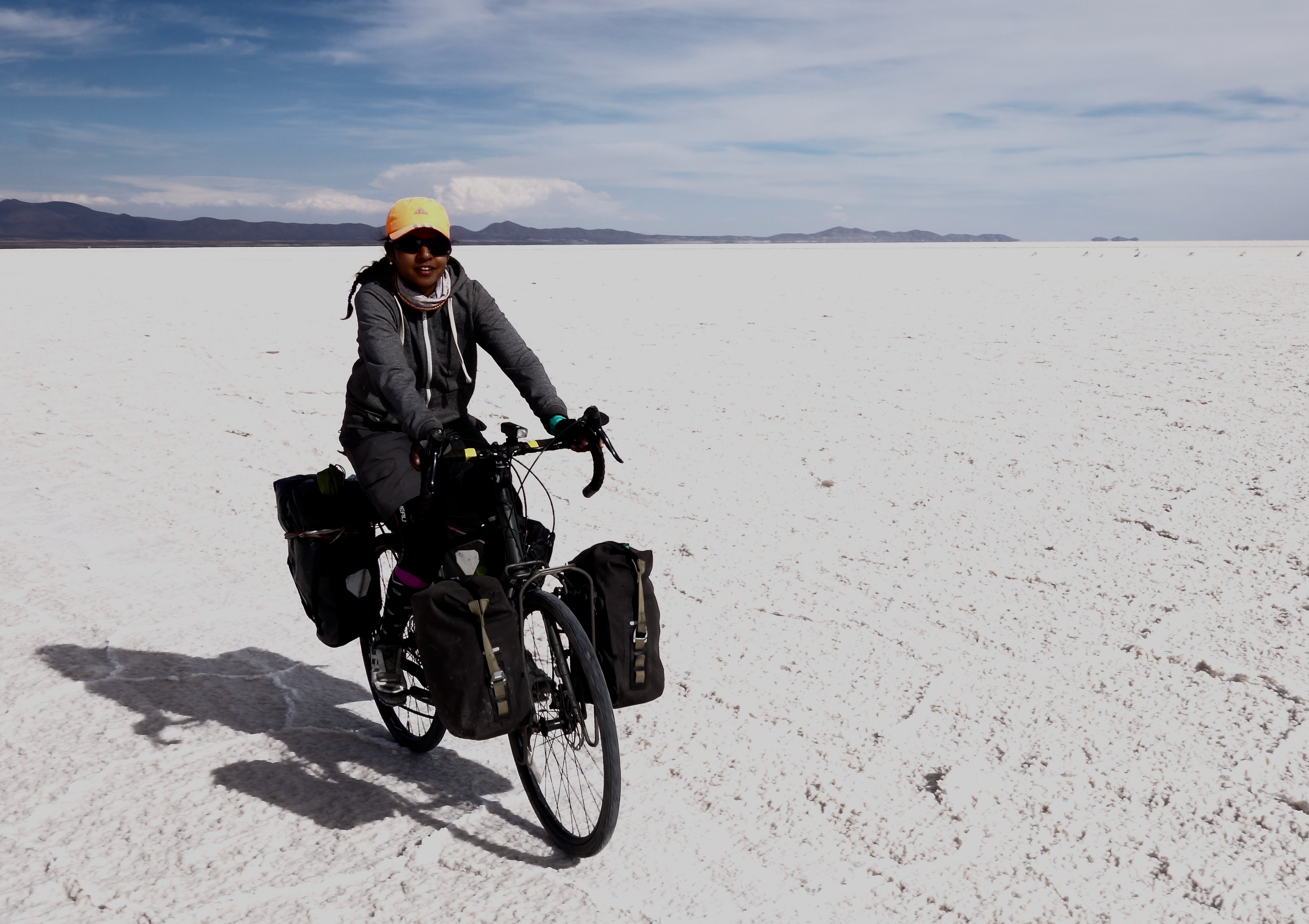 Cycling through the Uyuni Salt Flats in Bolivia, during a 24,000 km bicycle journey from Alaska to Argentina