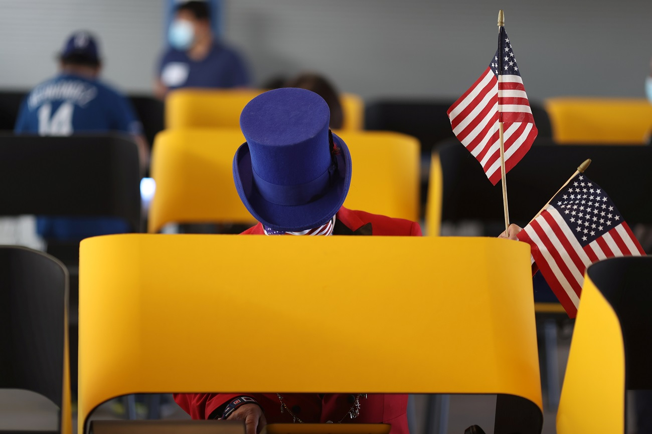 Jeffrey Stansfield, 54, votes in the U.S. presidential election on the first day of expanded California in-person voting, amid the global outbreak of the coronavirus disease (COVID-19), at Dodger Stadium sports venue in Los Angeles, California, U.S., October 30, 2020. REUTERS/Lucy Nicholson