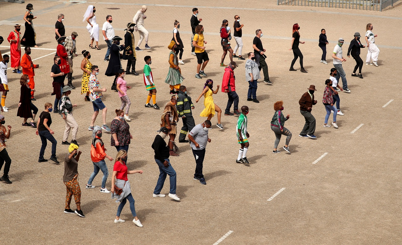 """South African actors rehearse their """"Jerusalema"""" dance steps as they prepare to shoot a special feature film based on the viral music hit, after an online dance challenge captivated millions around the world, at the Cape Town Film Studios in Cape Town, South Africa, September 24, 2020.  REUTERS/Mike Hutchings"""