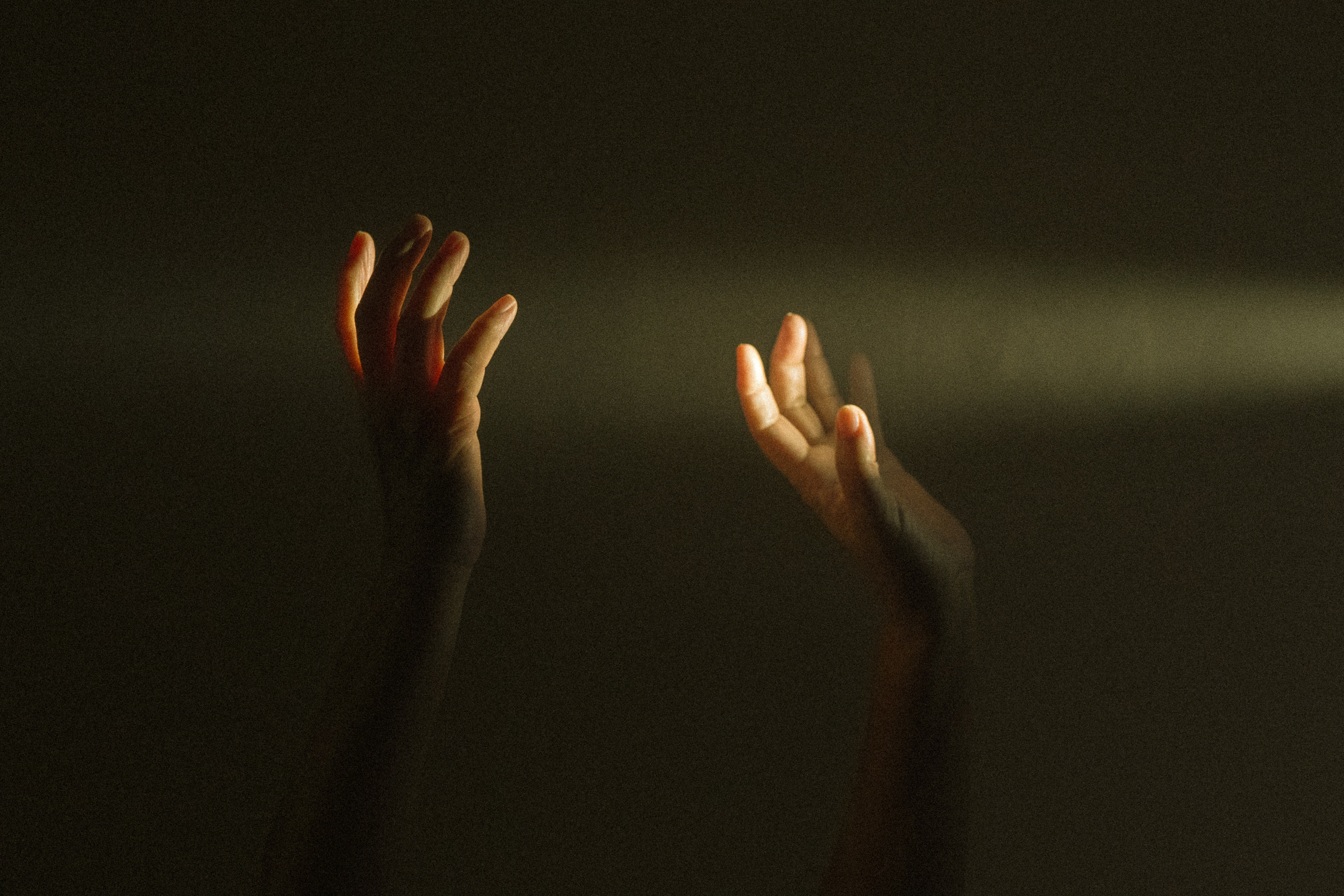 person with hands raised personifying mental health