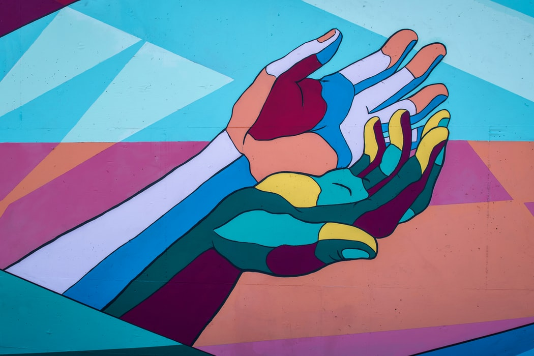 Raef Hamaed | Tim Mossholder Colorful Hands 2 of 3 / George Fox students Annabelle Wombacher, Jared Mar, Sierra Ratcliff and Benjamin Cahoon collaborated on the mural. / Article: https://www.orartswatch.org/painting-the-town-in-newberg/