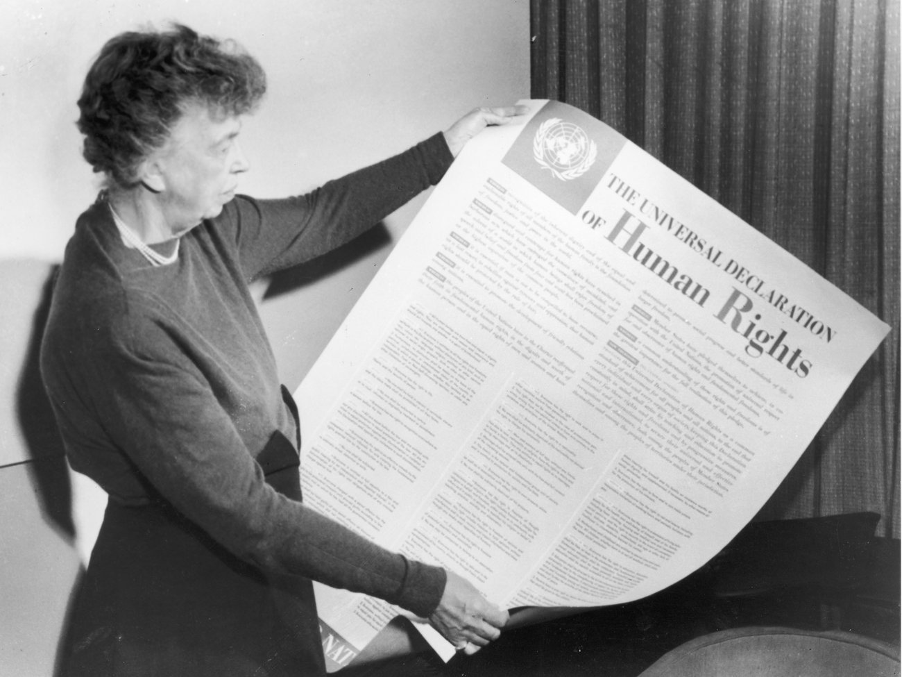 Eleanor Roosevelt holds up a copy of The Universal Declaration of Human Rights, adopted by the United Nations in December 1948.