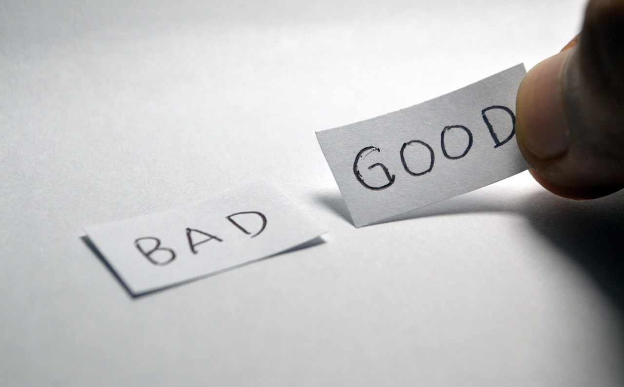 """Bad"" and ""Good"" written in a small piece of paper"