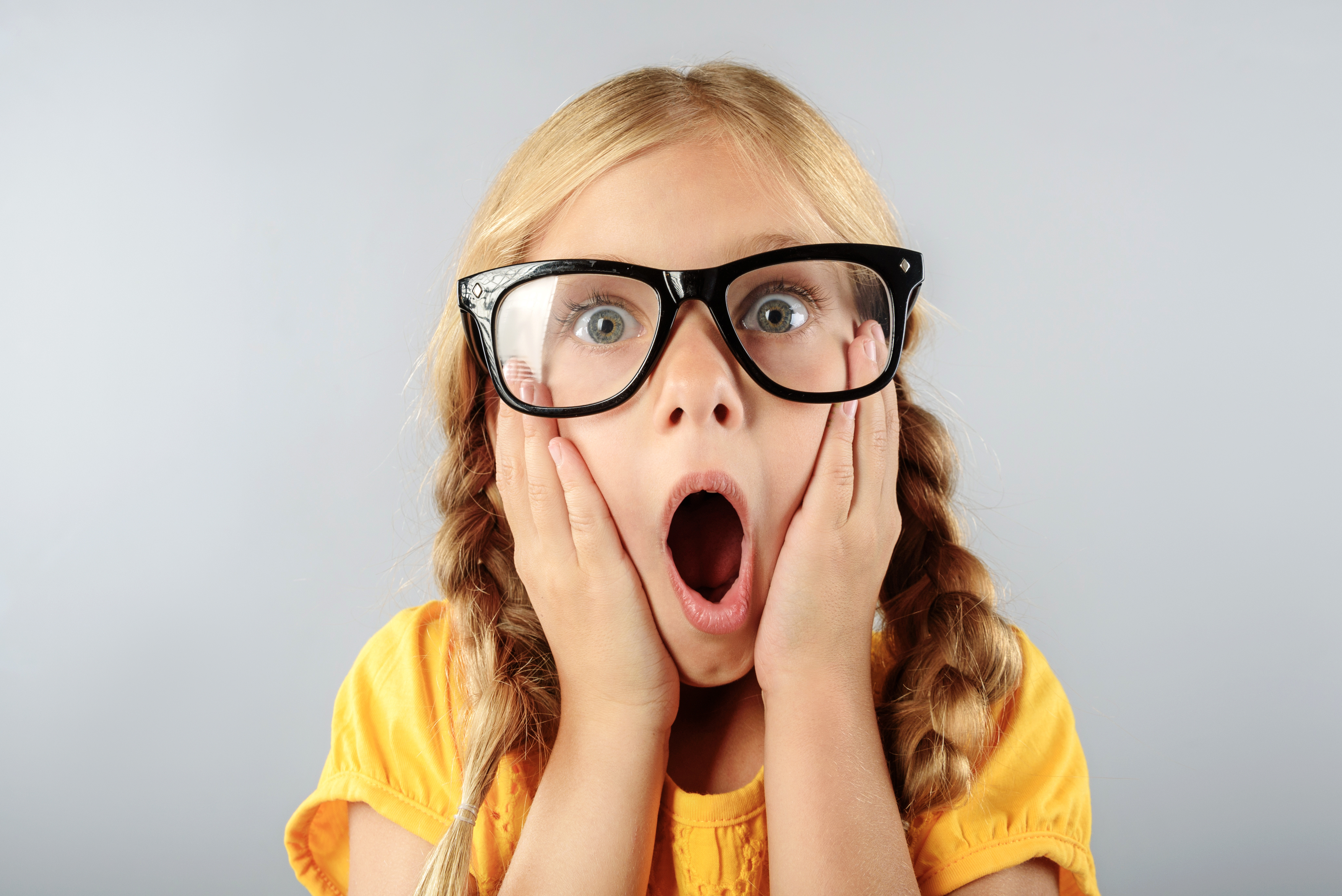 exited child in glasses with copy space