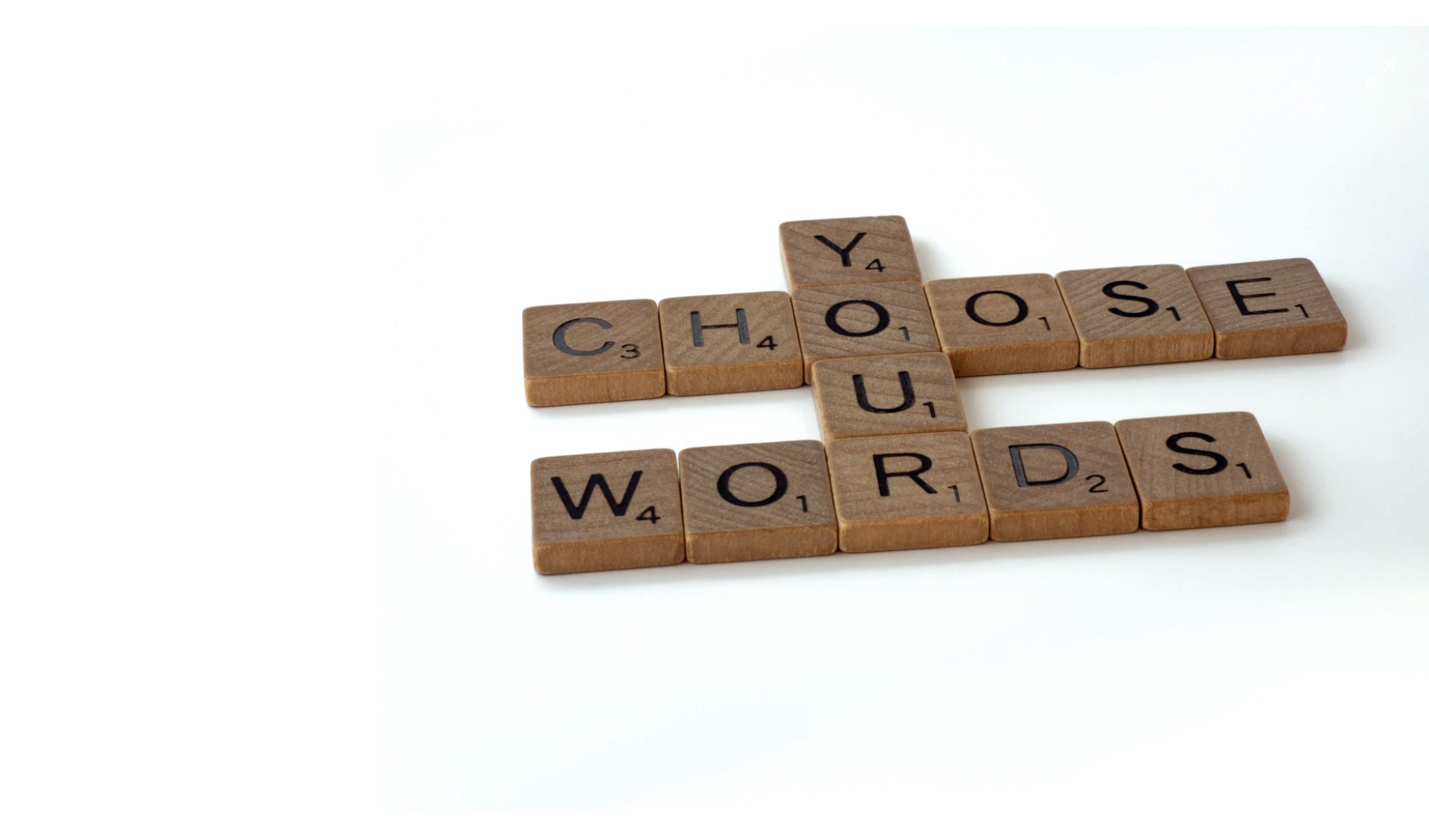 """Image of scrabble tiles arranged to say """"Choose Your Words"""""""