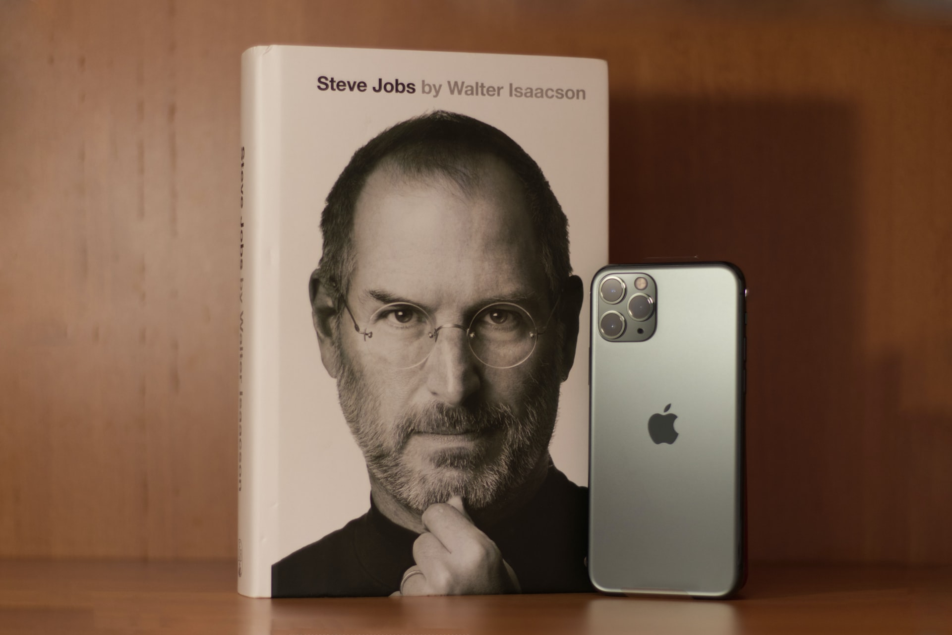 Steve jobs photo in a book cover and iPhone