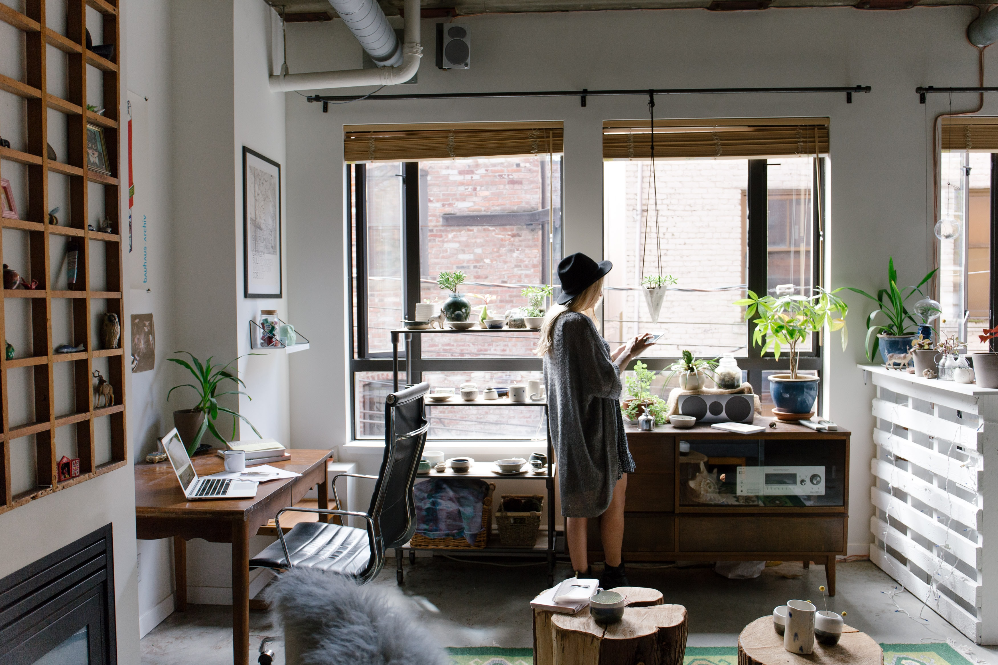 woman standing in her office with light coming in the room