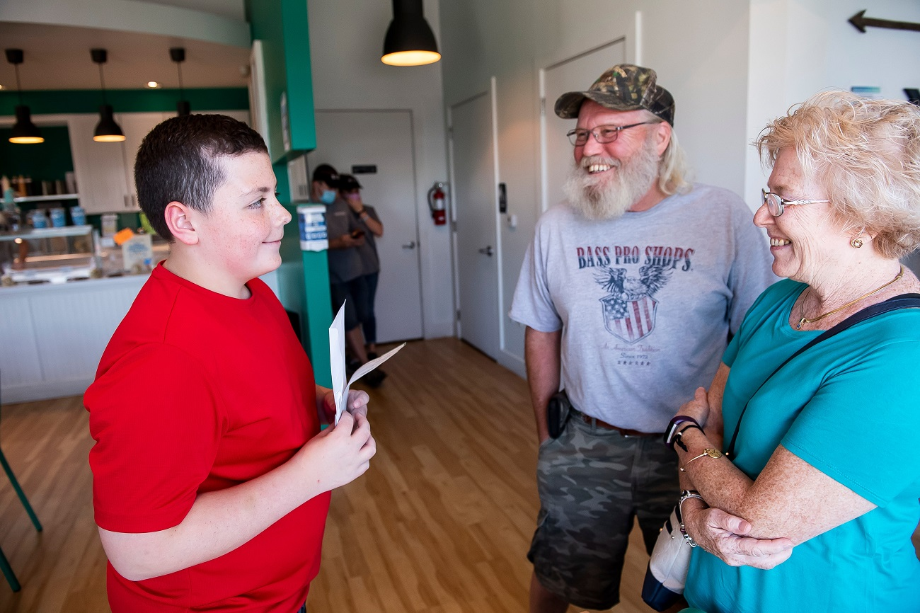 Trent Morea, 12, is greeted by his grandparents, Steve and Aimee Erb, after finding out he was named the Kids Wish Network's Hero of the Year on Aug. 19, 2020.Trent01