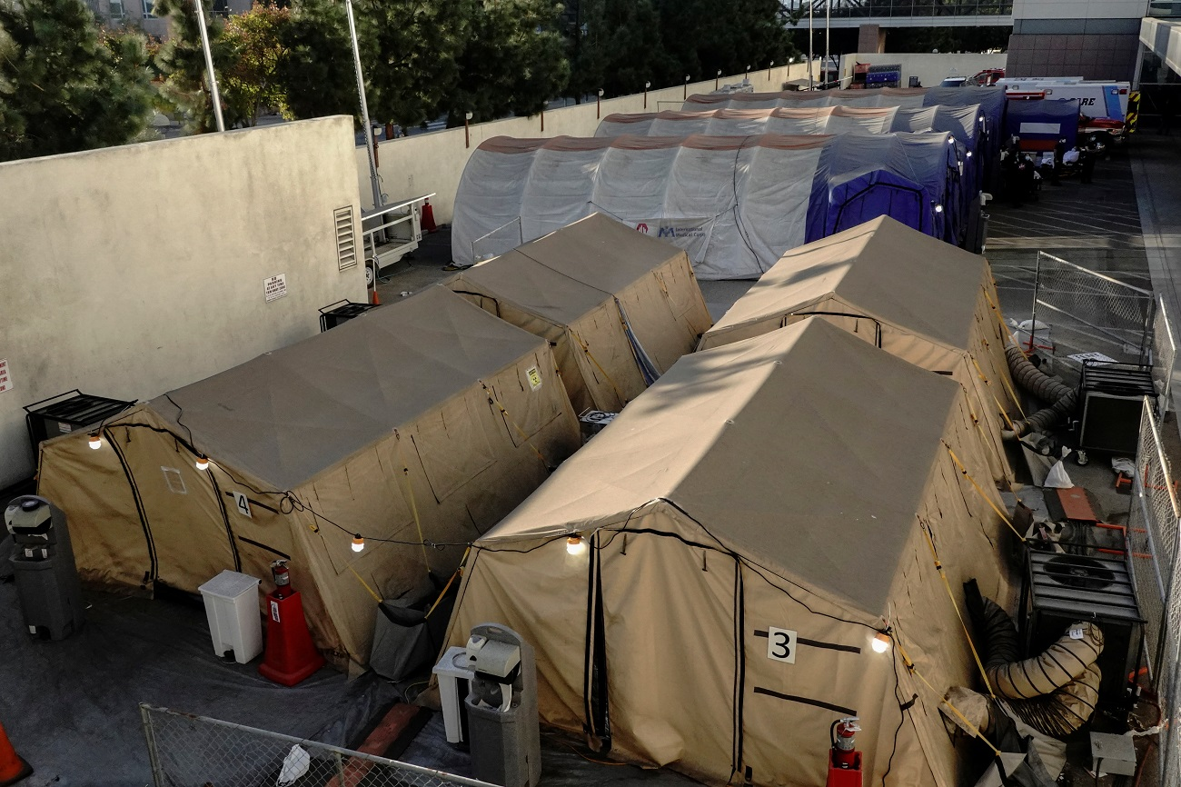 Triage tents for treating COVID-19 patients are seen outside LAC + USC Medical Center during a surge of coronavirus disease (COVId-19) cases in Los Angeles, California, U.S., December 27, 2020.  REUTERS/Bing Guan