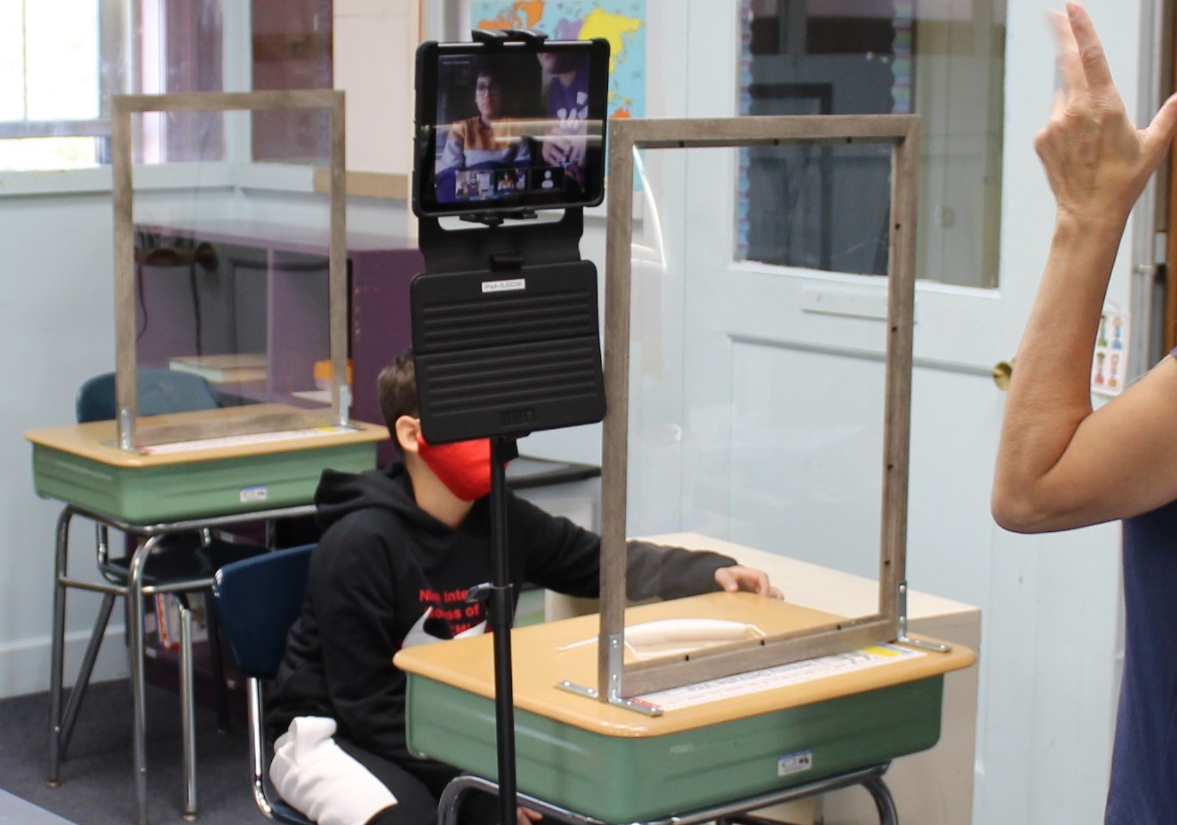 Sstudents use technology to facilitate hydrid learning and to communicate with other students in class during COVID-19.